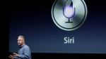 Apple's Phil Schiller talks about Siri with the new Apple iPhone 4S during an announcement at Apple headquarters in Cupertino, Calif., Tuesday, Oct. 4, 2011. (THE CANADIAN PRESS/AP, Paul Sakuma)