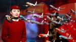 In this June 12, 2012, file photo, an Air China flight attendant stands near model planes at the International Air Transport Association (IATA) 68th Annual General Meeting (AGM) and World Air Transport Summit in Beijing. (AP Photo/Ng Han Guan, File)