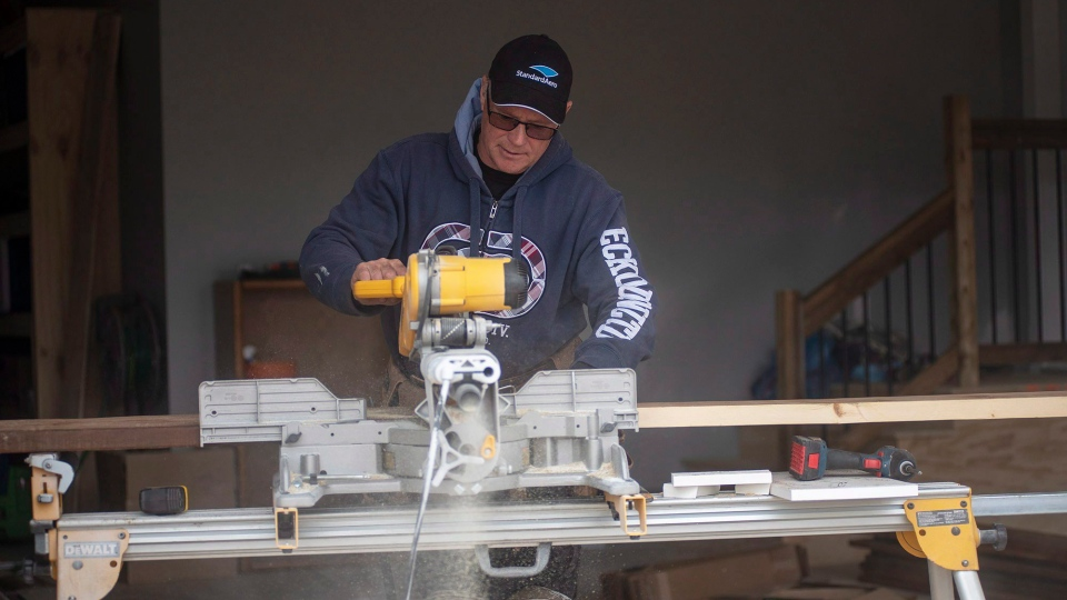 A man works on a new home in a subdivision near Charlottetown, P.E.I. on Thursday May 17, 2018.  (THE CANADIAN PRESS/Brian McInnis)