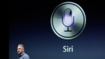 Apple's Phil Schiller talks about Siri with the new Apple iPhone 4S during an announcement at Apple headquarters in Cupertino, Calif., Tuesday, Oct. 4, 2011. THE CANADIAN PRESS/AP, Paul Sakuma