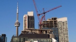 Canada Mortgage and Housing Corp. says the pace of housing starts in January held steady compared with December. Construction cranes are seen in Toronto on Wednesday, July 5, 2017. THE CANADIAN PRESS/Frank Gunn