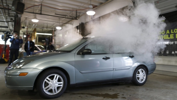 Smoke created by water vapor billows out of a car