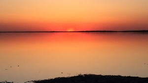 First sunset of the summer at Watchorn Bay near Moosehorn, Manitoba. Photo by Marilyn McMillan.