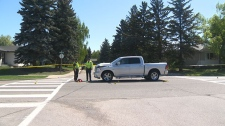 Police taped off an intersection in the southeast after two people were hit by a vehicle on Tuesday morning.