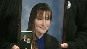 Terrie Ann Dauphinais's mother holds a photograph of her daughter in 2012 on the 10 year anniversary of the homicide in Citadel