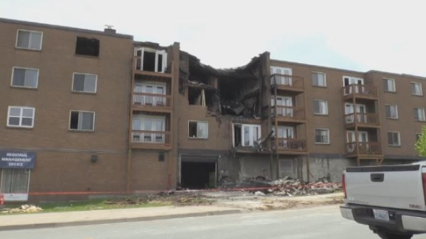 A woman was killed after fire ripped through this apartment building in Dartmouth on May 19, 2018.