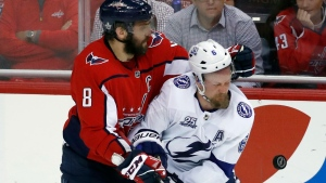 Washington Capitals left wing Alex Ovechkin (8) collides with Tampa Bay Lightning defenseman Anton Stralman (6) during the third period of Game 6 of the NHL Eastern Conference finals hockey playoff series, Monday, May 21, 2018, in Washington. (AP Photo/Alex Brandon)