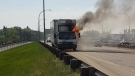 A truck, the lone refrigerated truck belonging to the non-profit CHEP Good Food, burns on Saskatoon's Idylwyld Freeway on Tuesday, May 22, 2018.