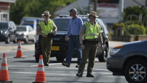 Maryland State Police divert traffic at Belair Road and Chapel Road after a Baltimore County officer was killed in Perry Hall, Md., May 21, 2018. (Jerry Jackson/The Baltimore Sun via AP)