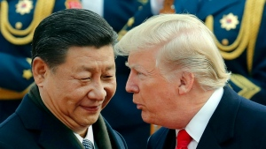 U.S. President Donald Trump, right, chats with Chinese President Xi Jinping during a welcome ceremony at the Great Hall of the People in Beijing on  Nov. 9, 2017. (AP Photo/Andy Wong)
