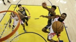Houston Rockets' James Harden, right, drives past Golden State Warriors' Jordan Bell, second from right, during the second half in Game 4 of the NBA basketball Western Conference Finals in Oakland, Calif. on Tuesday, May 22, 2018. (AP Photo/Marcio Jose Sanchez, Pool)