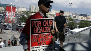 Culinary Union members file into a university arena to vote on whether to authorize a strike in Las Vegas on Tuesday, May 22, 2018. (AP Photo/Isaac Brekken)