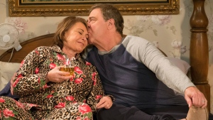 In this image released by ABC, Roseanne Barr, left, and John Goodman appear in a scene from the season finale of 'Roseanne,' airing Tuesday, May 22. (Adam Rose/ABC via AP)