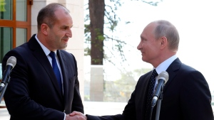 Russian President Vladimir Putin, right, shakes hands with Bulgarian President Rumen Radev after their talks in the Bocharov Ruchei residence in the Black Sea resort of in Sochi, Russia, Tuesday, May 22, 2018. (AP Photo/Alexander Zemlianichenko)