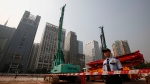 In this Oct. 26, 2009 file photo, security workers guard at construction site of the U.S. Consulate compound in Guangzhou in southern China's Guangdong province. (Chinatopix via AP, File)