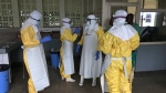 A team from Medecins Sans Frontieres (Doctors Without Borders) dons protective clothing and equipment as they prepare to treat Ebola patients in an isolation ward of Mbandaka hospital in Congo, Sunday, May 20, 2018. (Louise Annaud/Medecins Sans Frontieres via AP)