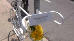 A 'ghost bike' in honour of Douglas Crosbie is shown affixed to a post near Dundas Street and Jones Avenue on Wednesday. Crosbie was struck and killed by a truck last week.