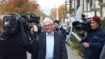 Former German Soccer Federation President, Theo Zwanziger, speaks with journalists as he leaves a hotel in Diez, western Germany, Tuesday Nov. 3, 2015.