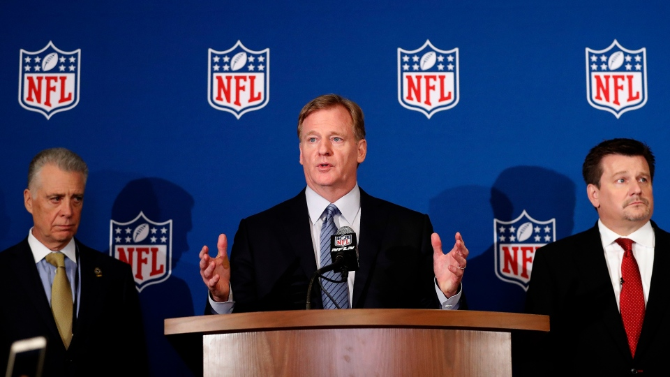 NFL commissioner Roger Goodell, center, is flanked by Pittsburgh Steelers president Art Rooney II, left, and Arizona Cardinals owner Michael Bidwill at the news conference May 23, 2018, in Atlanta. (AP Photo/John Bazemore)
