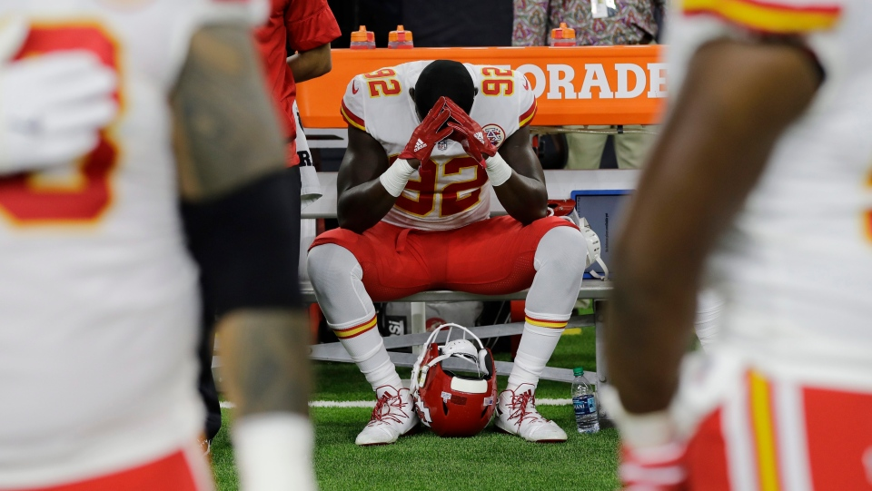 Kansas City Chiefs linebacker Tanoh Kpassagnon sits on the bench during the national anthem before a game on Oct. 8, 2017. (AP Photo/David J. Phillip)