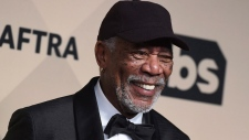 In this Jan. 21, 2018, file photo, Morgan Freeman poses with his Life Achievement Award in the press room at the 24th annual Screen Actors Guild Awards at the Shrine Auditorium & Expo Hall in Los Angeles. Selena Gomez, Lily Collins, Freeman and Jennifer Aniston will be among the stars at WE Day California, a youth empowerment event in Southern California on April 19, 2018. (Photo by Jordan Strauss/Invision/AP, File)