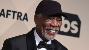 Hollywood actor Morgan Freeman poses with a Life Achievement Award from the Screen Actors Guild in this January 2018 file image. (Jordan Strauss/Invision/AP)
