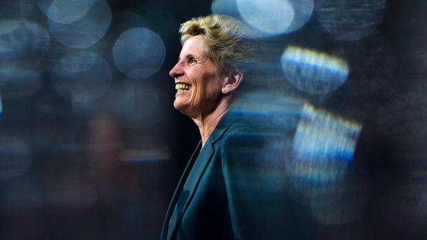 Ontario Liberal Leader Kathleen Wynne is pictured between glasses as she speaks during a campaign stop at Crosscut Distillery in Sudbury, Ont., on Wednesday, May 23, 2018. THE CANADIAN PRESS/Nathan Denette