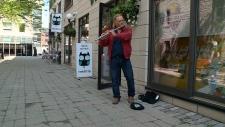 Thomas Brawn plays his flute in Byward Market.
