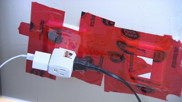 Janice Connell had the outlets in her condo taped to try to eliminate odours coming through the cracks. (CTV)