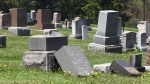 Toppled tombstones are seen at Hillview Cemetery in Woodstock on May 23, 2013 -- two weeks after they were knocked over during a mischief spree.
