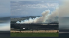 Grass fire west of Cochrane on May 23, 2018 (image courtesy: Lynn Dove)
