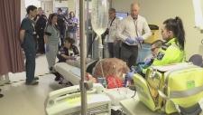 Students watch a trauma simulation at HSN