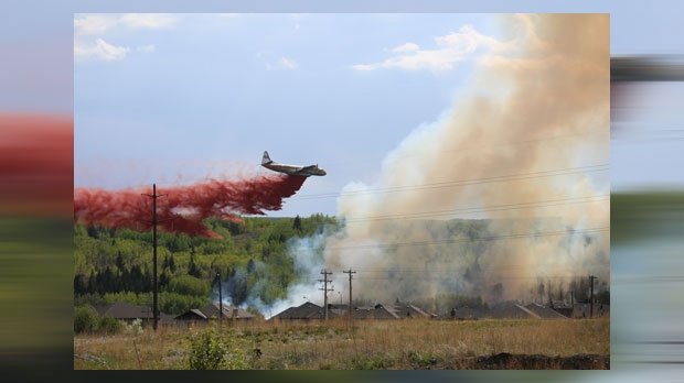 An aircraft drops a retardant on the wildfire near Cochrane on Wednesday afternoon (photo courtesy: Carly Dudley)