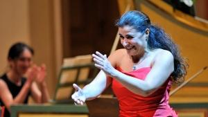 Italian mezzo-soprano Cecilia Bartoli applauds the orchestra after their concert at the Rudolfinum in Prague Thursday, June 9, 2011. (AP Photo/CTK, Michal Dolezal)