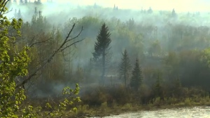 A wildfire west of Cochrane is under control but dry conditions in the area remain a concern for firefighters.