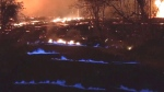 The blue flames are created when hot lava buries and burns plants and trees and the gas flows through the ground and up through existing cracks.