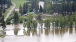 Flood waters from Kettle River are shown flowing into Rock Creek, B.C., on Thursday, May 17, 2018. THE CANADIAN PRESS/Jonathan Hayward