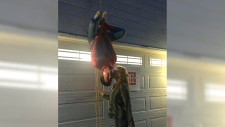 A teen hung out of a window as Spiderman just to