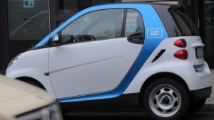 A Car2Go vehicle is parked on a street in central Berlin on Wednesday, Feb. 19, 2014. The service, operated by Mercedes-Benz and Smart car manufacturer Daimler launched a new intercity service recently. (AP Photo/Frank Jordans)