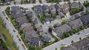 Houses and townhouses are seen in an aerial view, in Langley, B.C., on Wednesday May 16, 2018. (THE CANADIAN PRESS/Darryl Dyck)