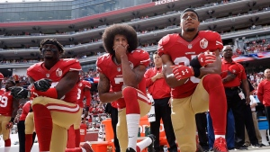 In this Oct. 2, 2016, file photo, San Francisco 49ers outside linebacker Eli Harold, left, quarterback Colin Kaepernick, center, and safety Eric Reid kneel during the national anthem before the team's NFL football game against the Dallas Cowboys in Santa Clara, Calif. .(AP Photo/Marcio Jose Sanchez, File)