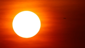 The sun rises as a plane passes over Mexico City, Wednesday, May 23, 2018. (AP Photo/Marco Ugarte)