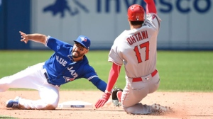Los Angeles Angels designated hitter Shohei Ohtani (17) steals second base ahead of the tag from Toronto Blue Jays second baseman Devon Travis (29)during eighth inning American League baseball action in Toronto on Thursday, May 24, 2018. (THE CANADIAN PRESS/Nathan Denette)