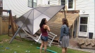 Breanna Wheeler, left, and CTV reporter Maria Weisgarber, right, look at Wheeler's collapsed deck.