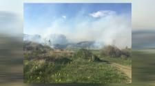 Smoke in an undeveloped area between the community of Tuscany and Stoney Trail on Thursday (image courtesy: Amit Saduera)