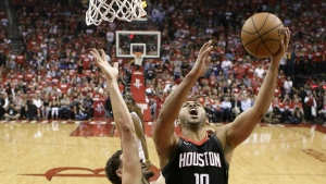 Houston Rockets guard Eric Gordon, right, shoots past Golden State Warriors guard Klay Thompson during the first half in Game 5 of the NBA basketball playoffs Western Conference finals in Houston, Thursday, May 24, 2018. (AP Photo/David J. Phillip)