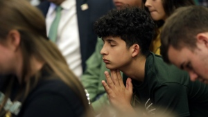 Santa Fe students takes part in a roundtable discussion in Austin, Texas, hosted by Texas Gov. Gregg Abbott to address safety and security at Texas schools in the wake of the shooting at Santa Fe, Texas on Thursday, May 24, 2018. (AP Photo/Eric Gay)