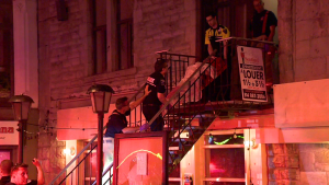 Emergency crews carry a man with head injuries out of an apartment on St. Denis St. on May 24, 2018 (CTV Montreal/Cosmo Santamaria)