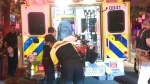 Paramedics place a man with head injuries in an ambulance on St. Denis St. on May 24, 2018 (CTV Montreal/Cosmo Santamaria)