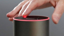 "A new Amazon Echo is displayed during a program announcing several new Amazon products by the company, Wednesday, Sept. 27, 2017, in Seattle. Amazon says it is cutting the price of its Echo smart speaker to $100 from $180, improving the sound quality and upgrading its appearance with six new ""shells."" The next generation speaker, which is powered by Amazon's Alexa voice assistant, will have a dedicated woofer and a tweeter for the first time, as well as Dolby sound. (AP Photo/Elaine Thompson)"